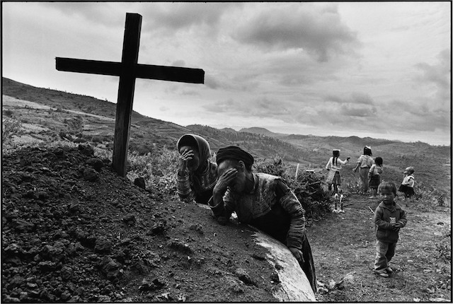 Lu Nan. Yunnan Province (1993). Miao tribe Catholics visiting the grave of a relative.