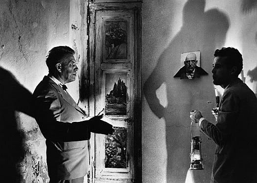 Dr. Alfred Kinsey and Kenneth Anger viewing Crowley's Satanic Frescoes in Thelema Abbey, Sicily.